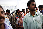 Patients wait to see the visiting doctors in the local hospital in Chalisgaon, Maharashtra, India. Rotary Club organises a free medical camp for the poor and needy. India's leading Micro and plastic surgeons visit the medical camp and provide free medical service.