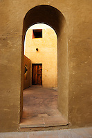 Dubai.  Archway leads to inner courtyard of Bab al Shams desert resort. .