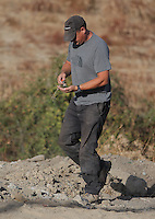 Pictured: A forensic archaeologist moves a tortoise to safety while working at the second site in Kos, Greece. Tuesday 11 October 2016<br /> Re: Police teams led by South Yorkshire Police are searching for missing toddler Ben Needham on the Greek island of Kos.<br /> Ben, from Sheffield, was 21 months old when he disappeared on 24 July 1991 during a family holiday.<br /> Digging has begun at a new site after a fresh line of inquiry suggested he could have been crushed by a digger.