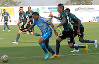 MONTERIA - COLOMBIA - 13-04-2015: Martin Arzuaga (Izq) jugador de Jaguares FC disputa el balón con Alcatraz Garcia (Der) jugador de Atlético Nacional durante partido entre Jaguares FC y Atlético Nacional por la fecha 15 de la Liga Aguila I 2015 jugado en el estadio Municipal de Monteria. / Martin Arzuaga (L) player of Jaguares FC vies for the ball with Alcatraz Garcia (R) player of Atletico Nacional during a match between Jaguares FC and Atletico Nacional for the  date 15 of the Liga Aguila I 2015 at the Municipal de Monteria Stadium in Monteria city, Photo: VizzorImage / Jose Perdomo / Cont.