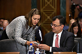 Karan Bhatia, Vice President for Government Affairs and Public Policy at Google, looks at a phone before the Subcommittee on the Constitution on Capitol Hill in Washington D.C., U.S. on July 16, 2019.<br /> <br /> Credit: Stefani Reynolds / CNP