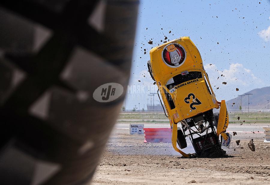 Jun. 26, 2010; Tooele, UT USA; LOORRS pro lite unlimited driver Aaron Daugherty crashes end over end during qualifying for round seven at Miller Motorsports Park. Mandatory Credit: Mark J. Rebilas-US PRESSWIRE
