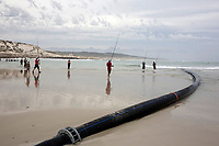 KHAYELITSHA, SOUTH AFRICA – FEBRUARY 8: A pipe is seen on the beach on February 8, 2018 at Monwabisi in Khayelitsha, about 40 kilometers outside of Cape Town, South Africa. The city of Cape Town is building a desalination plant to clean seawater to drinking water. The city is experiencing a shortage of water and water restrictions are in place. The big users of water are not the poor in the townships but the wealthy people in the suburbs, who have pools and gardens. (Photo by Per-Anders Pettersson)