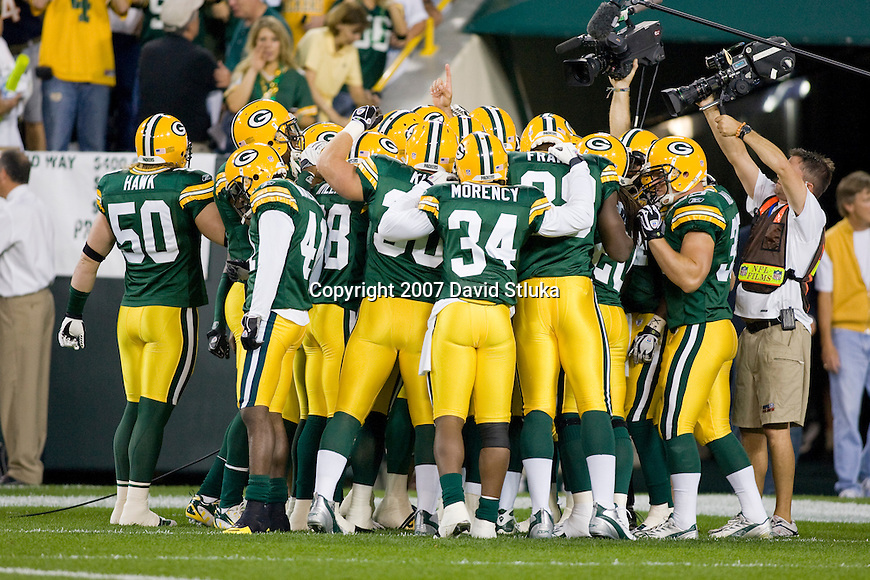 The Green Bay Packers huddle prior to the game during an NFL football game against the Chicago Bears at Lambeau Field on October 7, 2007 in Green Bay, Wisconsin. The Bears beat the Packers 27-20. (Photo by David Stluka)