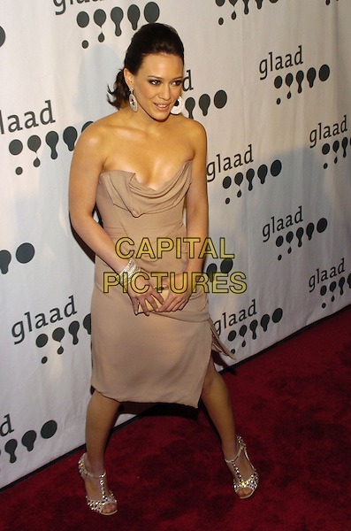 HILARY DUFF.Attending the GLAAD Media Awards (Gay and Lesbian Alliance Against Defamation) New York at the Mariott Marquis Hotel, New York City, NY, USA.March 26th, 2007.full length strapless low cut dress cleavage beige grey gray jewelled strappy sandals shoes bracelets clutch bag earrings discs.CAP/ADM/BL.©Bill Lyons/AdMedia/Capital Pictures *** Local Caption ***