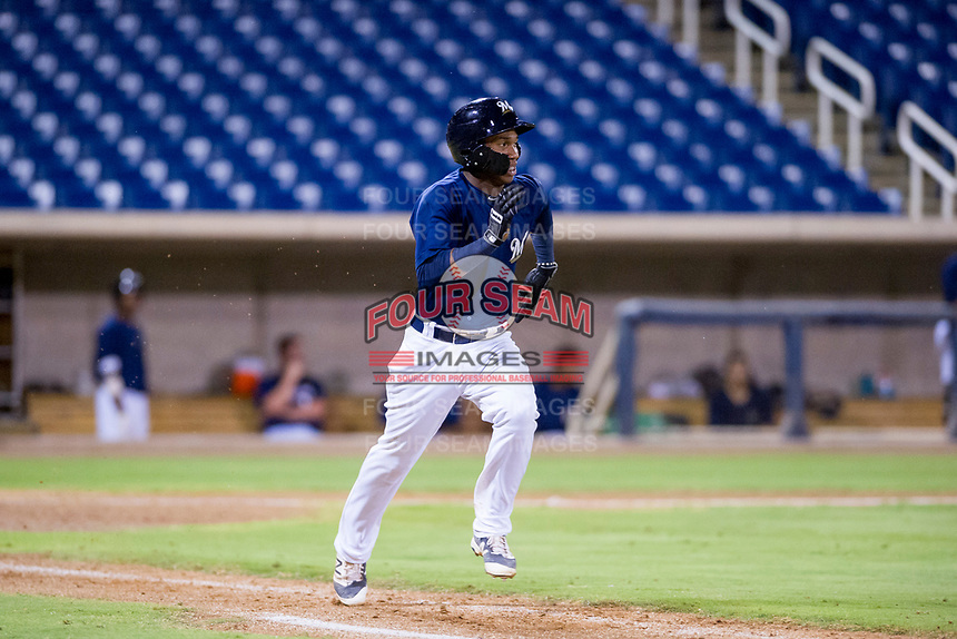 AZL Brewers second baseman Jean Carmona (5) hustles down the first base line against the AZL Cubs at Maryvale Baseball Park in Phoenix, Arizona. AZL Cubs defeated the AZL Brewers 9-1. (Zachary Lucy/Four Seam Images)