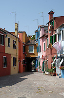 Brightly coloured houses, on the island of Burano, Venice famous for lace production. Venice, Italy.