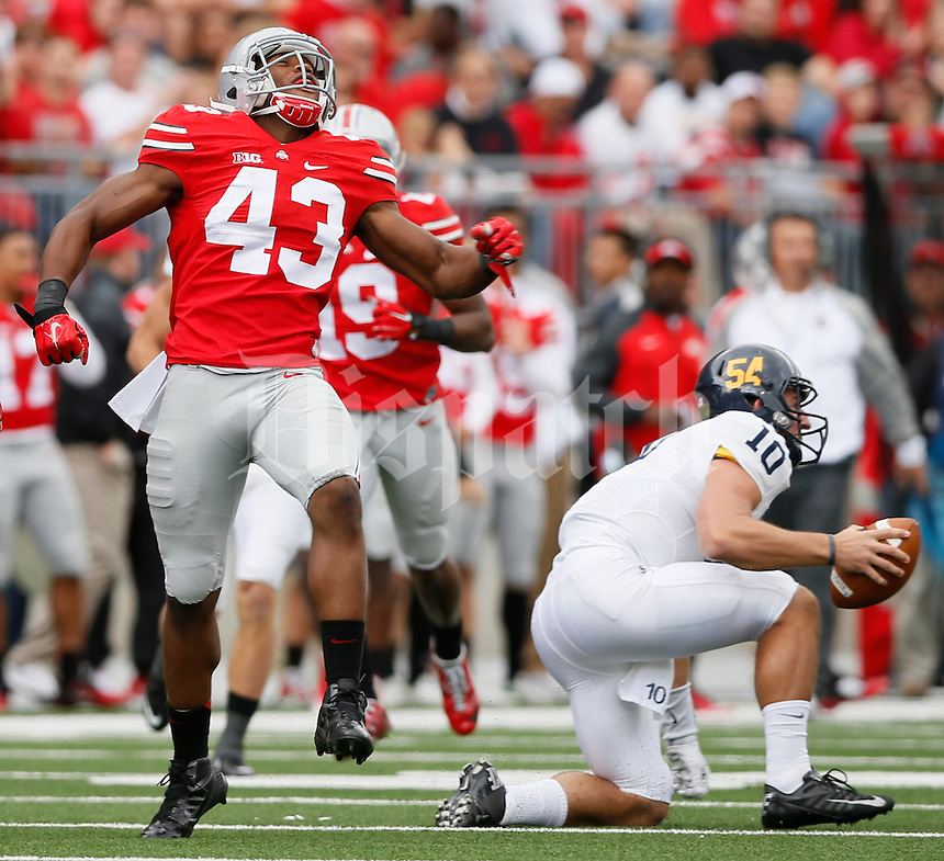 Ohio State Buckeyes linebacker Darron Lee (43) celebrates after sacking Kent State Golden Flashes quarterback Colin Reardon (10) during Saturday's NCAA Division I football game at Ohio Stadium in Columbus on September 13, 2014. Ohio State won the game 66-0. (Dispatch Photo by Barbara J. Perenic)