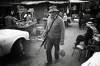 Israel, March and April 1987  ..A trip through Israel and its occupied territories during the first Intifada, Palestinian uprising in 1987.  armed settler shopping for groceries at Hebron Arab market...Photo Kees Metselaar