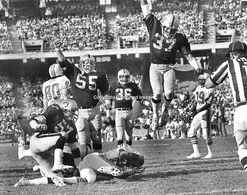 Raiders celebrate safety, #57 Randy McClenahan, #55 Matt Millen, #36 Mike Davis, and #37 Lester Hayes...against the Miami Dolphins..(1980 photoby Ron Riesterer)