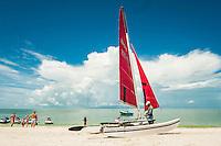 Charles Escarra, preps a Hobbie Cat Sailboat, for a lesson, at Bonita Jetski & Paarasail at Doc's Beach House on Bonita Beach, Florida. Photo by Debi Pittman Wilkey.