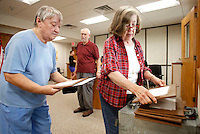 NWA Democrat-Gazette/DAVID GOTTSCHALK  Judy Beavers (from right), Mort Gitelman and MacZeatta (cq) Ramsey cast their ballots on the first day of early voting on the proposed Fayetteville Uniform Civil Rights Protection ordinance Tuesday, September 2, 2015 at the Washington County Clerk and Probate office in the Washington County Courthouse in Fayetteville. Early voting continues Wednesday, Thursday and Friday and then again from 7:30 a.m. to 7:30 p.m. Tuesday, Sept. 8.