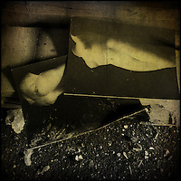 Postcards of nude statues in an abandoned house, texture applied.