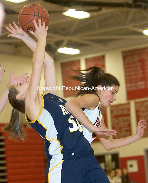 SOUTHBURY, CT. 08 March 2012-030812SV20-#5 Morgan Metcalf of Pomperaug High battles for the rebound with #50 Brittney Lovett of RHAM during the CIAC Class L quarterfinal in Southbury Thursday..Steven Valenti Republican-American