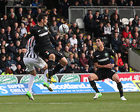 Anthony Watt under pressure from Kenny McLean gets to the ball watched by Beram Kayal in the St Mirren v Celtic Clydesdale Bank Scottish Premier League match played at St Mirren Park, Paisley on 20.10.12.