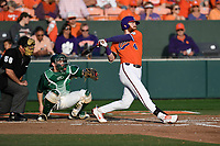 Third baseman Grayson Byrd (4) of the Clemson Tigers bats in a game against the William and Mary Tribe on February 16, 2018, at Doug Kingsmore Stadium in Clemson, South Carolina. The catcher is Hunter Smith; the umpire is Danny Everett. Clemson won, 5-4 in 10 innings. (Tom Priddy/Four Seam Images)