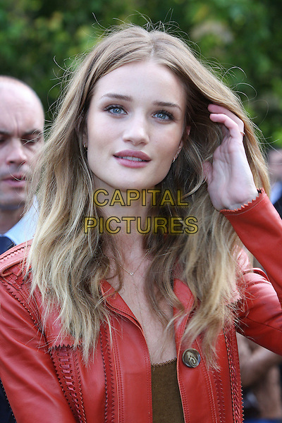 Rosie Huntington-Whiteley.Burberry Prorsum S/S Show Arrivals at Kensington Gardens, London, England..September 19th 2011.LFW headshot portrait orange leather  hand.CAP/ROS.©Steve Ross/Capital Pictures