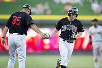 Toby Thomas (4) of the Winston-Salem Dash shakes hands with third base coach Joel Skinner (35) after hitting a solo home run against the Salem Red Sox at BB&T Ballpark on June 16, 2016 in Winston-Salem, North Carolina.  The Dash defeated the Red Sox 7-1.  (Brian Westerholt/Four Seam Images)