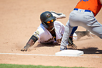 Bradenton Marauders Oneil Cruz (13) slides into third base during a Florida State League game against the St. Lucie Mets on July 28, 2019 at LECOM Park in Bradenton, Florida.  Bradenton defeated St. Lucie 7-3.  (Mike Janes/Four Seam Images)