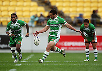 Manawatu's Tomasi Cama (left) and Aaron Smith watch as Isaac Thompson kicks for touch. Air NZ Cup - Wellington Lions v Manawatu Turbos at Westpac Stadium, Wellington, New Zealand. Saturday 3 October 2009. Photo: Dave Lintott / lintottphoto.co.nz