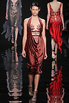 "Model walks runway in a bordeaux draped charmeuse dress lace underpinning from the Reem Acra Fall 2016 ""The Secret World of The Femme Fatale"" collection, at NYFW: The Shows Fall 2016, during New York Fashion Week Fall 2016."