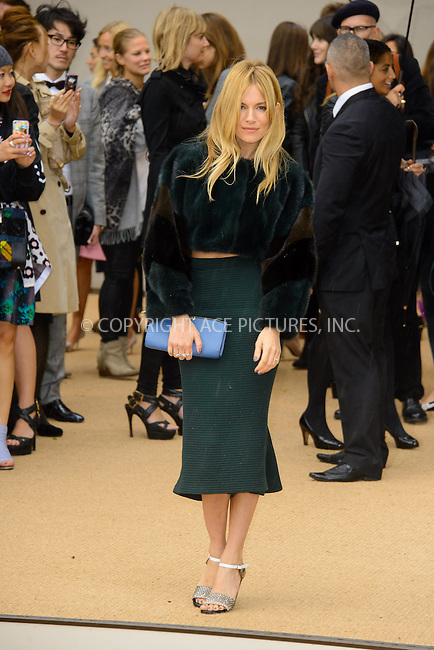 WWW.ACEPIXS.COM<br /> <br /> US Sales Only<br /> <br /> September 16 2013, London<br /> <br /> Sienna Miller arriving at the Burberry Prorsum show at London Fashion Week SS14 at Kensington Gardens on September 16, 2013 in London, England<br /> <br /> ACE Pictures, Inc.<br /> tel: 646 769 0430<br /> Email: info@acepixs.com<br /> www.acepixs.com