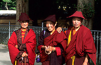 Female monks in colorful robes  in capital city of Lhasa Tibet China