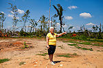Pastor Sandra Fendley, of Vaughn United Methodist Church in Vaughn, Georgia stands near where her church used to stand before an April tornado tore apart the community. The church will be rebuilt down the road in a different location.