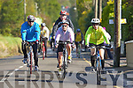 Cyclists pass through Currow village during the Castleisland fun cycle on Sunday ..