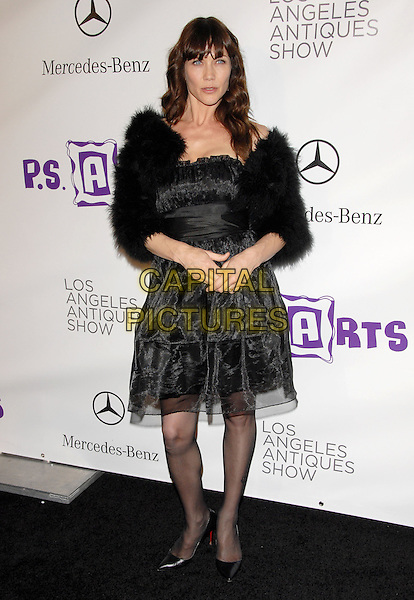 STACY HAIDUK.at the 15th Annual L.A. Antiques Show 2010 held at Barkar Hangar in Santa Monica, California, USA, .April 21st, 2010..full length black dress fur fluffy coat jacket shoes christian louboutin tights .CAP/RKE/DVS.©DVS/RockinExposures/Capital Pictures