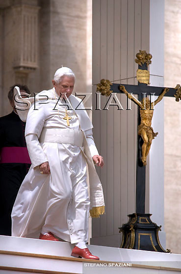 Pope Benedict XVI waves to the faithful during his weekly general audience in St. Peter's square at the Vatican, Wednesday April 22, 2009.