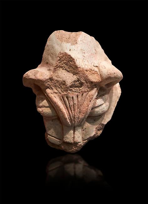 Hittite terra cotta head of a lion. Hittite Period 1650 - 1450 BC, Ortakoy Sapinuva . Çorum Archaeological Museum, Corum, Turkey. Against a black bacground.