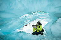 Photographer photographing on Franz Josef Glacier, Westland National Park, West Coast, World Heritage Area, New Zealand