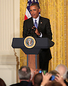 United States President Barack Obama makes remarks at a reception for the nation's mayors in the East Room of the White House in Washington, DC on January 21, 2016.<br /> Credit: Dennis Brack / Pool via CNP