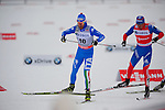 HOLMENKOLLEN, OSLO, NORWAY - March 16: (L-R) Roland Clara of Italy (ITA) and Alexander Legkov of Russia (RUS) during the Men 50 km mass start, free technique, at the FIS Cross Country World Cup on March 16, 2013 in Oslo, Norway. (Photo by Dirk Markgraf)