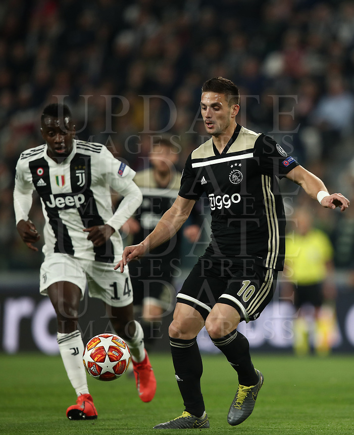 Football Soccer: UEFA Champions UEFA Champions League quarter final second leg Juventus - Ajax, Allianz Stadium, Turin, Italy, March 12, 2019. <br /> Ajax's Dusan Tadic (r) in action with Juventus' Blaise Matuidi (l) during the Uefa Champions League football match between Juventus and Ajax  at the Allianz Stadium, on March 12, 2019.<br /> UPDATE IMAGES PRESS/Isabella Bonotto
