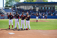 Batavia Muckdogs Mike Garzillo (11), Javier Lopez (23), Samuel Castro (25), and Eric Gutierrez (43) stand for the national anthem before a game against the Auburn Doubledays on September 5, 2016 at Dwyer Stadium in Batavia, New York.  Pitcher Dustin Beggs (47) is at the mound with umpires Emil Jimenez (left) and Robert Nunez (right) standing with catcher Alex Jones (55) at home plate.  Batavia defeated Auburn 4-3. (Mike Janes/Four Seam Images)