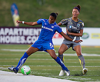 Fabiana (15) of the Boston Breakers fights for the ball with Estelle Johnson (24) of the Philadelphia Independence during a game at John A. Farrell Stadium in West Chester, PA.  Boston defeated Philadelphia, 2-1.
