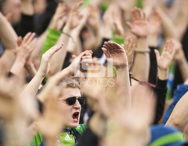 A Seattle Sounders FC fan chants during pregame activities before play between the Seattle Sounders FC and the Houston Dynamo at Qwest Field in Seattle Friday March 25, 2011. The match ended in a 1-1 draw.