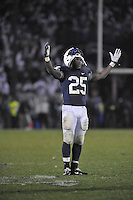 29 October 2011:  Penn State RB Silas Redd (25) lifts his hands and celebrates after scoring the game winning touchdown. The Penn State Nittany Lions defeated the Illinois Fighting Illini 10-7 to at Beaver Stadium in State College, PA..