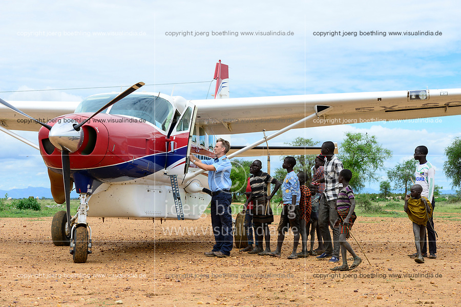 UGANDA, Karamoja, Kotido, MAF Mission Aviation Fellowship, airplane at bush airstrip, Karamojong tribe, flight service for missionaries, NGO and relief goods