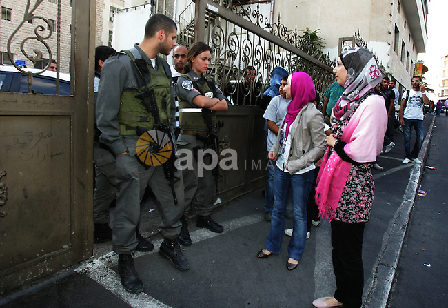 Israeli soldiers try to stop Palestinian conference, Jerusalem, Israel, on Sept. 25, 2011. Where Israeli police stormed a hotel in Jerusalem to prevent a Palestinian education curriculum conference. Photo by Mahfouz Abu Turk