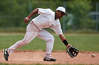 25 April 2010: Chabelo Reyes Calderon takes infield practice during game 1/week 3 of the French Elite season won 12-4 by Rouen over the PUC, at the Pershing Stadium in Vincennes, near Paris, France.