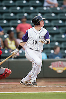 Zack Collins (30) of the Winston-Salem Dash follows through on a 3-run home run against the Potomac Nationals at BB&T Ballpark on July 15, 2016 in Winston-Salem, North Carolina.  Collins was the first round selection (10th overall) of the Chicago White Sox in the 2016 First Year Player Draft.  (Brian Westerholt/Four Seam Images)
