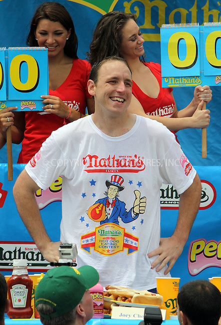 WWW.ACEPIXS.COM . . . . .  ....July 4 2011, New York City....Joey Chestnut on the way to winning the 2011 Nathan's Famous Fourth of July International Hot Dog Eating Contest in Coney Island on July 4, 2011 in Brooklyn, New York City. Joey Chestnut won the men's competition by eating 62 hot dogs and Sonya Thomas won the women's event by eating 40 hot dogs in 10 minutes.....Please byline: CURTIS MEANS - ACE PICTURES.... *** ***..Ace Pictures, Inc:  ..Philip Vaughan (212) 243-8787 or (646) 679 0430..e-mail: info@acepixs.com..web: http://www.acepixs.com