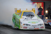 Oct. 31, 2008; Las Vegas, NV, USA: NHRA funny car driver Tony Bartone does a burnout during qualifying for the Las Vegas Nationals at The Strip in Las Vegas. Mandatory Credit: Mark J. Rebilas-