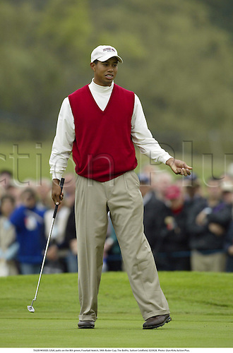 TIGER WOODS (USA) putts on the 8th green, Fourball Match, 34th Ryder Cup, The Belfry, Sutton Coldfield, 020928. Photo: Glyn Kirk/Action Plus....2002.putts putting.golf golfer player