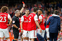 RED CARD - Referee, Jonathan Moss sends off the injured Ainsley Maitland-Niles of Arsenal during the Premier League match between Arsenal and Aston Villa at the Emirates Stadium, London, England on 22 September 2019. Photo by Carlton Myrie / PRiME Media Images.