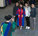 Yiran Zhang poses with friends and family members as DePaul University College of Law holds its commencement ceremony, Sunday, May 13, 2018, at the McCormick Place Grand Ballroom in Chicago, IL. Approximately 280 students received their Juris Doctors or Master of Laws degrees. (DePaul University/Jamie Moncrief)