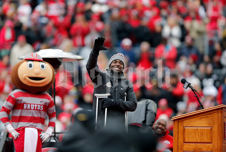 Quarterback J.T. Barrett waves during the Ohio State football National Championship celebration at Ohio Stadium on Saturday, January 24, 2015. (Columbus Dispatch photo by Jonathan Quilter)